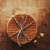 Caramel waffles tied up with jute bow Stock Photos