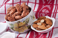 Caramelized almonds. Sweet caramelized almonds and required ingredients Royalty Free Stock Photos