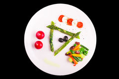 Caramelized asparagus. With caprese salad and other vegetables Royalty Free Stock Image