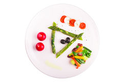 Caramelized asparagus. With caprese salad and othe vegetables Stock Photography