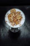 Caramelized bananas with yogurt, germ, honey. Caramelized bananas with yogurt, wheat germ, honey and pine nuts Royalty Free Stock Photo