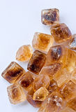 Caramelized cane sugar cubes on white Royalty Free Stock Photo