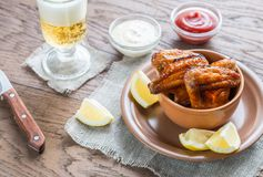 Caramelized chicken wings with glass of beer Stock Photo