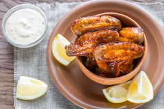 Caramelized chicken wings with spicy sauce Stock Images