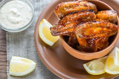 Caramelized chicken wings with spicy sauce Stock Photo