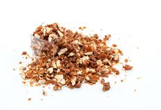 Caramelized crumbled Almonds. For topping on white background Royalty Free Stock Photo