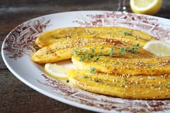 Caramelized fried bananas on vintage plate Royalty Free Stock Photography