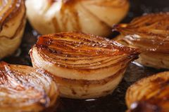 Caramelized onion halves with balsamic vinegar in a pan macro Stock Photos
