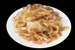 Caramelized Onions. Isolated on black background Royalty Free Stock Photography