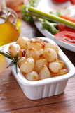 Caramelized onions. In small white bowl Royalty Free Stock Photos