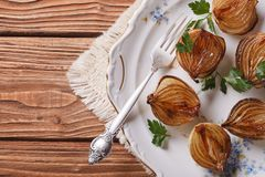 Caramelized onions on a white plate. horizontal top view Stock Photos