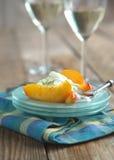 Caramelized Peaches with lime yogurt creme Stock Image