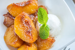 Caramelized peaches with vanilla ice cream Stock Photo