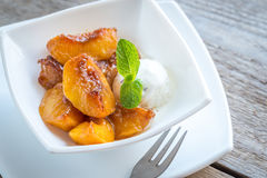 Caramelized peaches with vanilla ice cream Royalty Free Stock Image