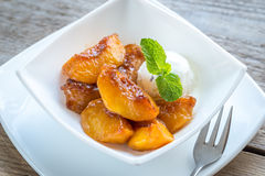 Caramelized peaches with vanilla ice cream Stock Photo