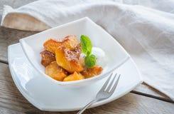 Caramelized peaches with vanilla ice cream Stock Photos
