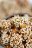 Caramelized peanuts with sesame Stock Photo