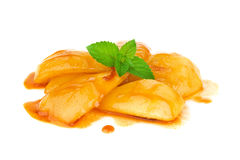 Caramelized pear in cognac sauce with leaf mint Stock Images