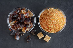 Caramelized sugar and brown cane sugar in glass bowls Royalty Free Stock Photo