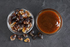 Caramelized sugar and liquid caramel in glass bowls Royalty Free Stock Photos