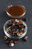 Caramelized sugar and liquid caramel in glass bowls Royalty Free Stock Photo