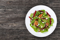 Caramelized walnuts salad on white plate Royalty Free Stock Photo