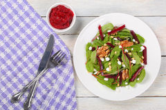 Caramelized walnuts salad on white plate Royalty Free Stock Images