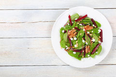 Caramelized walnuts salad on white plate Stock Photography