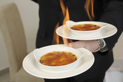 Caramelizing a Cr?me br?l e with a blowtorch Royalty Free Stock Images
