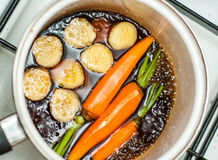 Caramelizing ginger and carrots Stock Photography