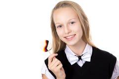 Caramella allegra della tenuta della ragazza con la bandiera della Germania Fotografie Stock Libere da Diritti