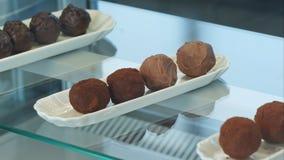 Caramella del cioccolato zuccherato in una finestra di deposito Fotografia Stock