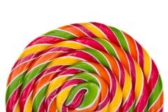 Caramella della lecca-lecca su fondo bianco, arcobaleno Immagine Stock