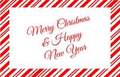 Caramella rossa Cane Border With Merry Christmas e messaggio del buon anno fotografia stock