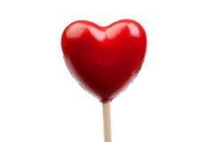 Caramella rossa con cuore a forma di Fotografie Stock