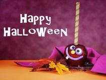 Caramella rossa felice della mela della caramella di Halloween con testo Immagine Stock