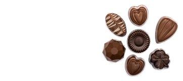 Caramelle di cioccolato su un bianco Fotografia Stock Libera da Diritti