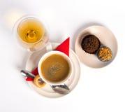 Caramelle e cognac del caffè Immagini Stock