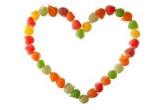 Caramelle nella figura di amore Immagini Stock