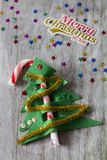 Caramelo Cane Christmas Tree con Feliz Navidad imagenes de archivo