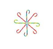 Caramelo Cane Snowflake en el fondo blanco imagenes de archivo