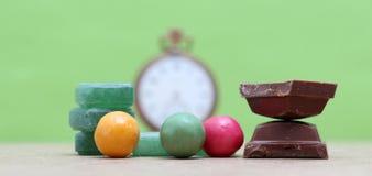Caramelo, chocolate y chicle verdes de mentas Foto de archivo