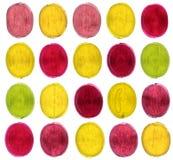 Caramelo coloreado en blanco fotografía de archivo libre de regalías