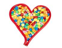 Caramelo coloreado en dimensión de una variable del corazón Fotografía de archivo libre de regalías