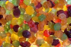Caramelo, colorido, asperjado con el azúcar en polvo rizado imagen de archivo