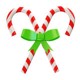 Caramelo de la Navidad con el arqueamiento verde en b blanco Fotografía de archivo libre de regalías
