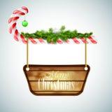 Caramelo de la Navidad con el tablero de madera Imagen de archivo libre de regalías