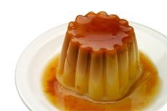 Caramelo de nata en un closeu del plato Imagen de archivo libre de regalías