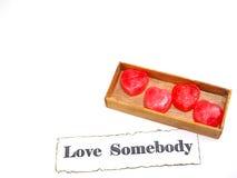 caramelo del corazón del ‡ del ¹ del à en caja con el texto en el fondo blanco Fotos de archivo