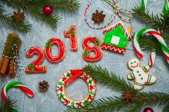 Caramelo del pan de jengibre de la tarjeta de felicitación del fondo del Año Nuevo de la Navidad Imagen de archivo libre de regalías
